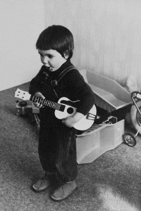 Manuel playing guitar at home, Gien 1974.
